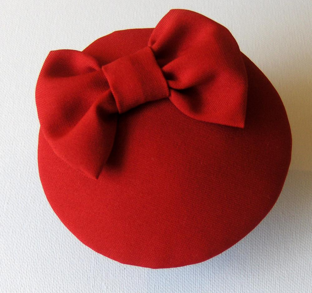 Red cocktail hat.