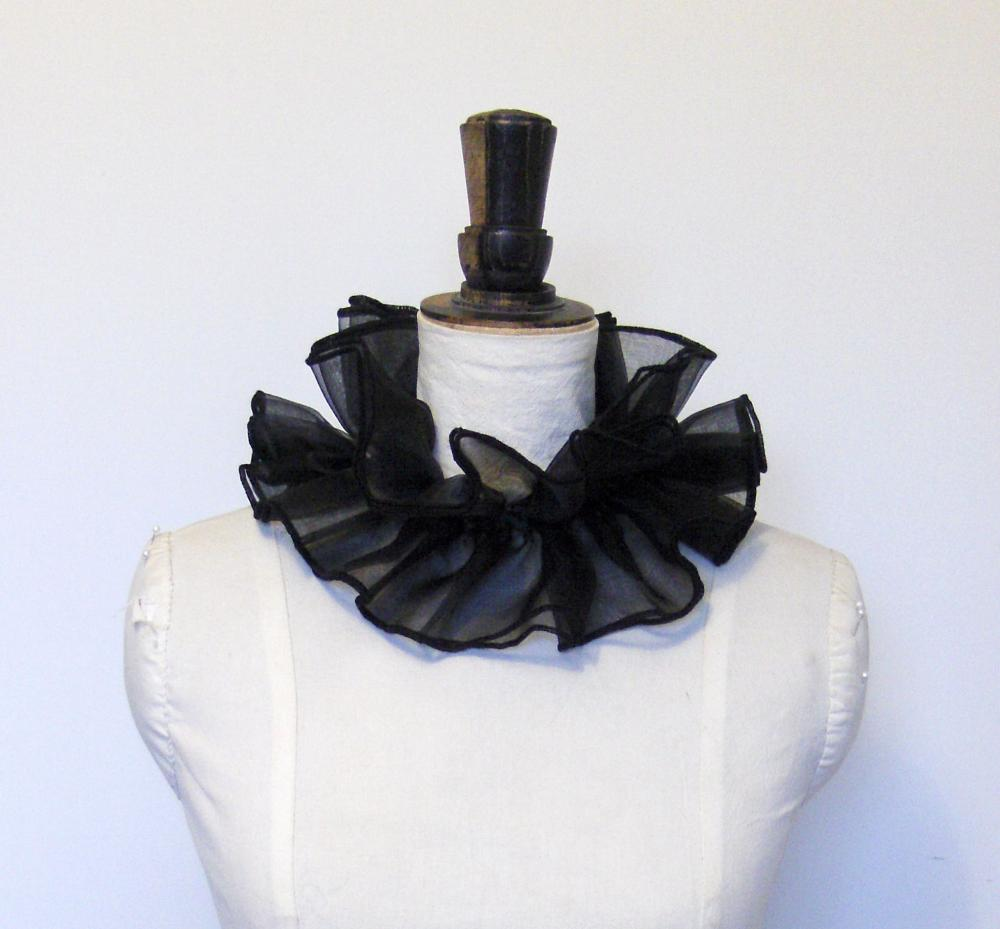 Black organza cirque neck ruffle.