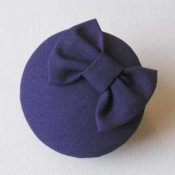 Purple bow cocktail hat.